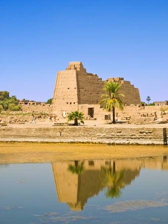 obelisc: Pylon reflected in the sacred pond of Karnak temple  Egypt Stock Photo