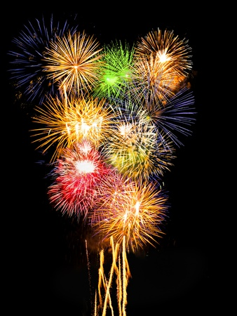 vertical composition: many colorful fireworks exploding simultaneously, vertical composition