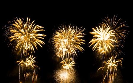 golden fireworks on black photo