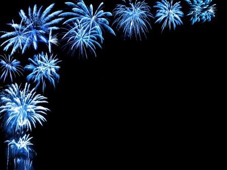 Blue fireworks as a partial frame on black