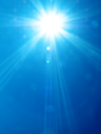 midday: Sun of midday on blue sky