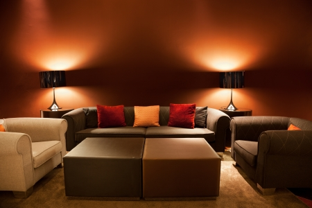 Empty sofas and armchairs in the lobby of a luxurious hotel