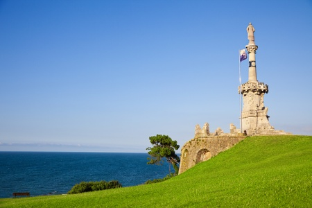 santander: Comillas marquis monument facing the Cantabric sea and blue sky, Comillas town, province of Santander, Spain Stock Photo