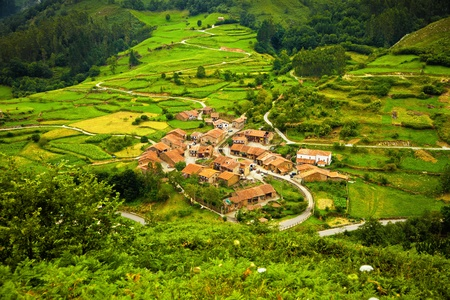 Aerial view of a typical town in Saja Valley, Cantabria, Spain Фото со стока