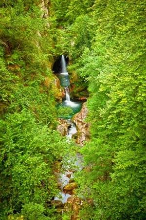 Waterfalls into a will deep forest, Saja river, Cantabria, Spain photo