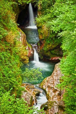 Waterfalls into a will deep forest, Saja river, Cantabria, Spain Stock Photo - 13202962