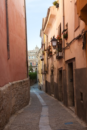 townhall: Old narrow street of Cuenca with the Townhall as background, Spain