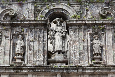 The Apostle Santiago and his disciples Athanasius and Theodore in East facade of Santiago de Compostela cathedral photo