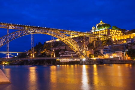 Dom Luis I bridge and Serra do Pilar monastery over Douro river at night  Porto, Portugal photo