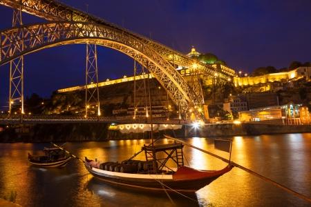 Dom Luis I bridge and Serra do Pilar monastery over Douro river at night  Porto, Portugal photo