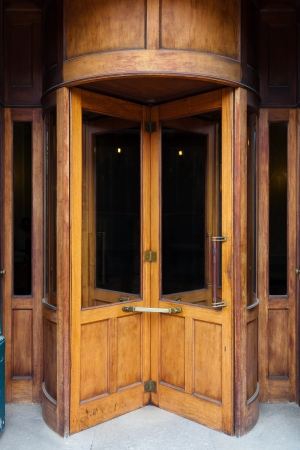 hotel door: Vintage wooden revolving door Stock Photo