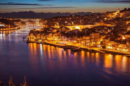 Panoramic of old Porto and Douro river at night, Portugal photo