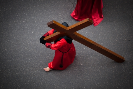 penitence: Nazareno carrying the Holy Cross as penitence  Holy Week in Valladolid, Spain