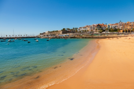 Beach, town and dock of Cascais at summer, Portugal