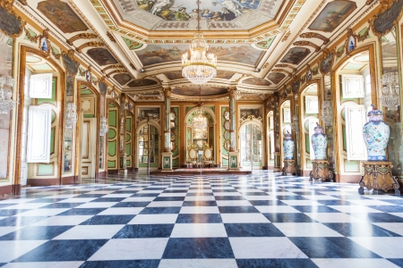 Queluz, Portugal - July 4, 2012: The Hall of Ambassadors in Queluz National Palace, Lisbon district, Portugal. Sometimes called the throne room or the Hall of Mirrors