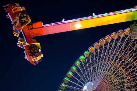 Ferris wheel and carnival ride at night  Motion blur