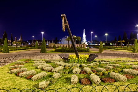 lisboa: Lisboa at night, old large anchor in a garden, Portugal Editorial