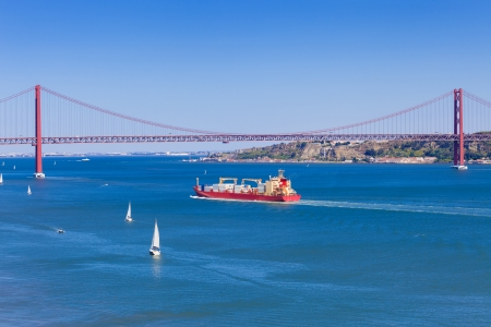 tagus: Panoramic of 25 de Abril bridge over Tagus river in Lisboa, Portugal