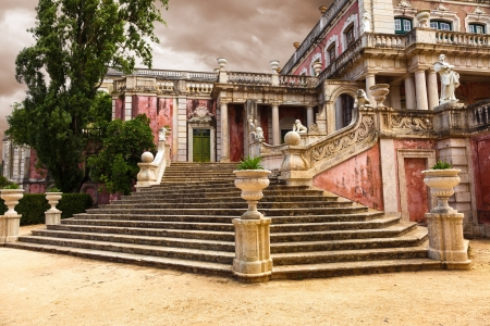 Queluz, Portugal - July 4, 2012: Staircase of the Robillon wing in Queluz National Palace, municipality of Sintra, Lisbon district, Portugal. Their design creates an illusion of a longer and higher perspective Editorial