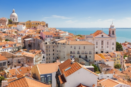 Panoramic of Alfama rooftops, one of the most popular neighborhoods of Lisboa, Portugal Stock Photo