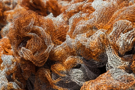 inshore: Orange fishing net, close up
