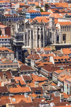 carmo: Bird view of Santa Justa elevator and Carmo church ruins over Lisboa rooftops  Portugal