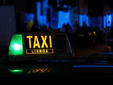 Lisboa taxi sign at night, Portugal