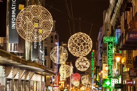 Madrid, Spain - December 13, 2012: Preciados street ornated for Christmas. Shopping street in Madrid downtown