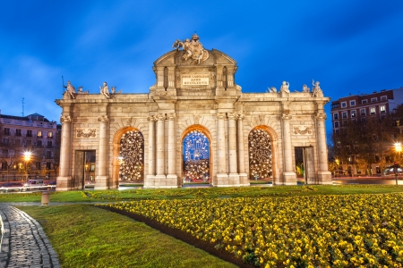 Puerta de Alcala at Christmas  Neo-classical landmark in the Plaza de la Independencia of Madrid, Spain photo