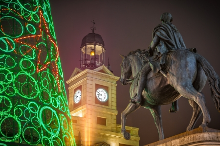 iii: Felipe III statue in the Puerta del Sol of Madrid at Christmas