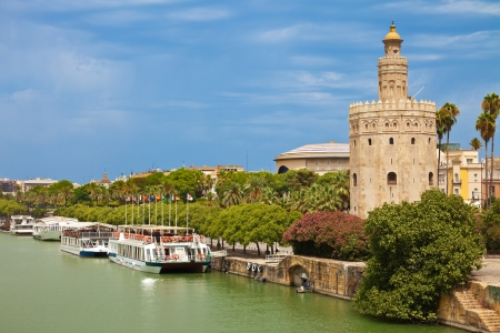 Torre del Oro over Guadalquivir river at a cloudy summer day  Sevilla, Spain