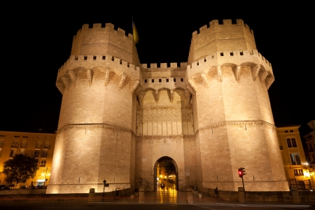 torres: Medieval twin-towered gates Torres de Serranos in Valencia at night, Spain