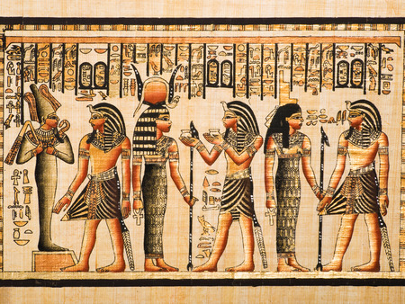 hieroglyphics: Egyptian papyrus showing the Pharaoh Tutankhamen and gods Osiris, Hathor and Isis