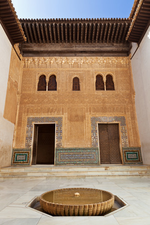 sectors: Granada, Spain - August 23, 2011: Alhambra de Granada. Comares courtyard. The Sultan received his vassals at the foot of the Façade of Comares, which separated the administrative and familiar sectors inside the Palace