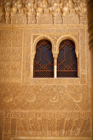 familiar: Granada, Spain - August 23, 2011: Alhambra de Granada. Comares facade detail. The Sultan received his vassals at the foot of the Façade of Comares, which separated the administrative and familiar sectors inside the Palace