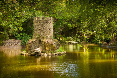 Sintra, Portugal - July 04, 2012: Fairytale pond in the park of Pena National Palace. Sintra, Portugal. UNESCO World Heritage Site and one of the Seven Wonders of Portugal