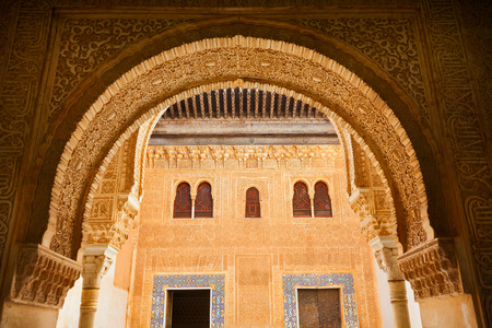 plasterwork: Granada, Spain - October 03, 2013: Alhambra de Granada. Comares courtyard. The Sultan received his vassals at the foot of the Facade of Comares, which separated the administrative and familiar sectors inside the Palace Editorial