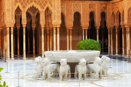 granada: Granada, Spain - October 03, 2013: Alhambra de Granada. The Court of the Lions with its famous white marble fountain Editorial