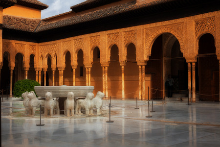 plasterwork: Granada, Spain - October 03, 2013: Alhambra de Granada. The Court of the Lions with its famous white marble fountain Editorial