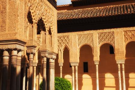 plasterwork: Granada, Spain - October 03, 2013: Alhambra de Granada. Muslim arches in the famous Court of the Lions. Spain. UNESCO World Heritage Site