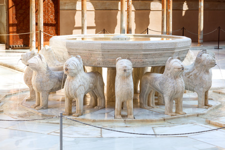 spanish culture: Granada, Spain - October 03, 2013: Alhambra de Granada. The famous white marble fountain of The Court of the Lions