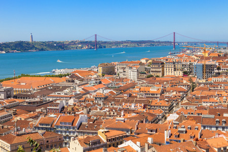 chiado: Bird view of Lisboa downtown. Panoramic of Baixa, Rossio and Chiado rooftops, with the Tagus river and bridge at the background. Portugal