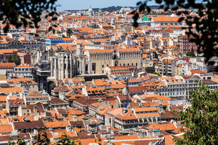 carmo: Bird view of Santa Justa elevator and Carmo church ruins over Lisboa rooftops. Portugal