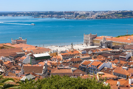 baixa: Bird view of Lisboa downtown. View of Baixa rooftops, the Commerce square and Tagus river. Portugal