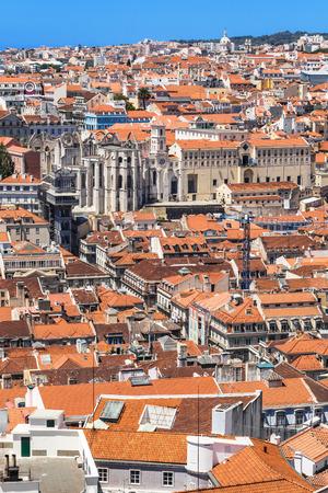 carmo: Bird view of Santa Justa elevator and Carmo church ruins over Lisboa rooftops. Portugal