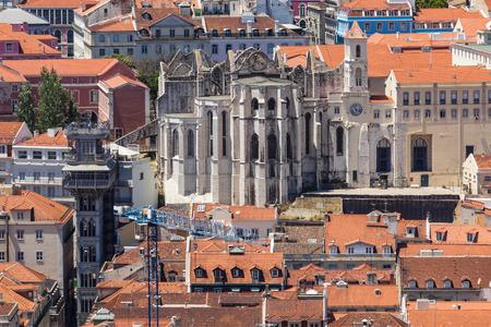 justa: Bird view of Santa Justa elevator and Carmo church ruins over Lisboa rooftops. Portugal