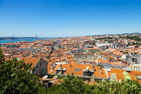 chiado: Bird view of Lisboa downtown. Great panoramic of Baixa, Rossio and Chiado rooftops, with the Tagus river and bridge at the background. Portugal