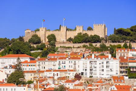 baixa: Sao Jorge (Saint George) castle over the old rooftops of Lisboa downtown. Portugal Editorial