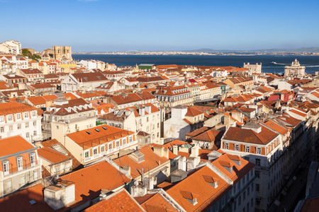 baixa: Bird view of Lisboa downtown. Baixa rooftops, with the Cathedral and Tagus river at the background. Portugal