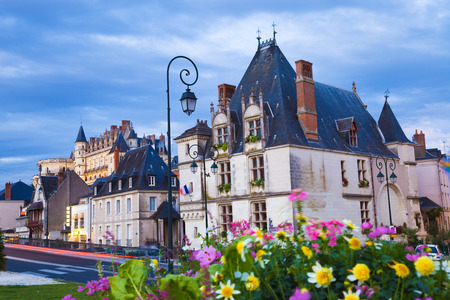 Amboise town at dusk, the chateau as background. France